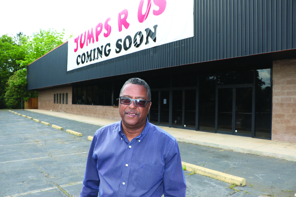 James Burnett stands in the parking lot of the former arts center, 5616 Memorial Drive in Stone Mountain, where he is opening the Elite Executive Center and Jumps R Us. Photo by Glenn L. Morgan/OCG News