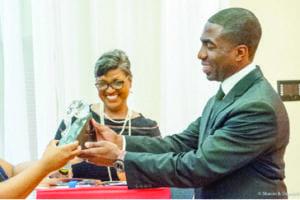 DeKalb County Interim CEO Lee May is presented the center's Spirit of Lou Walker Award