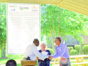 Rockdale Chairman Richard Oden present Jeff Beech, founder of Lighthouse Village and Phoenix Pass, and Jean Yontz, executive director, with proclamation declaring June 10, 2016 as Phoenix Pass Day in Rockdale County