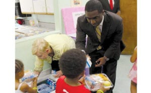 Interim CEO May and First Lady Deal served meals to youth during the kickoff summer meals program