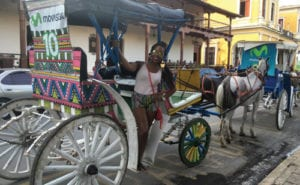 Exploring the beautiful historic city of Granada, Nicaragua on a horse drawn carriage.