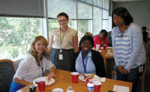 Attorneys Dana Pagan, Joelle Nazaire and Daniela Costan lunch with high school student Angelic Showalter on June 3 at the Gwinnett S.M.I.L.E. program.