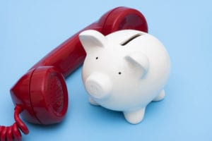 Telephone with piggy bank – call for help