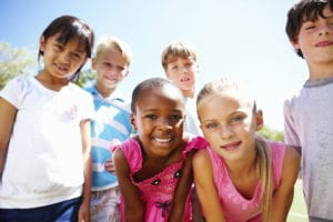 Closeup portrait of multi ethnic children giving you cute smiles