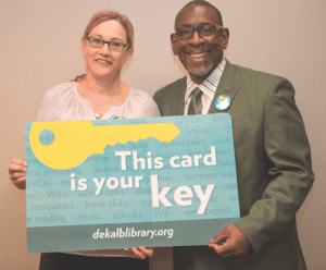 DeKalb Schools Superintendent R. Stephen Green and Library Director Alison Weissinger show off new, limited edition library card.