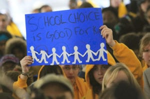 110125 Atlanta: Signs were everywhere Tuesday during the rally. Hundreds of parents and students attended the School Choice Celebration and Rally at the Georgia State Capitol Tuesday, Jan. 25, 2011. The gathering rallied to push state lawmakers to expand educational options for Georgia families. The event joined together unlikely allies, public and private school leaders in a display of unity where they urged lawmakers to expand scholarship opportunities so parents can better afford to pick their children's schools. Private schools want the state to raise the $50 million cap on the tax-credit scholarship that has helped hundreds of public school students transfer to private schools. Charter school officials want the state to support the continued funding of their campuses, which faces a state Supreme Court challenge from a handful of Georgia public school systems. The rally comes as the country celebrates National School Choice Week. David Pusey, director of a Center for an Educated Georgia, said more metro Atlanta parents appear to be concerned about choice than ever before, especially with accreditation problems at Atlanta Public Schools. John Spink jspink@ajc.com