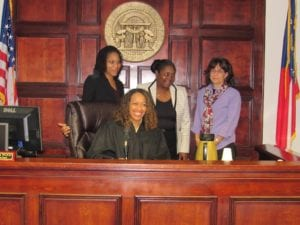 Stephanie Curtis, Denise Lofton and Betsy Mitchell were sworn in as CASA volunteers on Dec. 7. Photo provided.