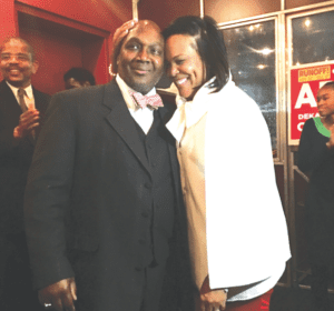 Gregory Adams gets a hug from his wife, Jacqueline, at his victory party, which was held at Marlow's Tavern in Atlanta. Photo provided.