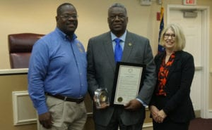 Chairman-Elect Oz Nesbitt and Commissioner Doreen Williams present Chairman and CEO Richard Oden a proclamation decalring Dec. 14 as 'Richard A. Oden Day'