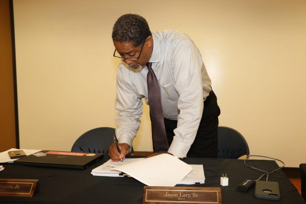 Jason signing