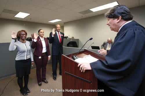 L-R: Stonecrest City Councilmembers Diane Adoma (District 5), Jazzmin Cobble (District 3), and Jimmy Clanton (District 1) were sworn in by Municipal Judge Jonathan Weintraub for their first full term on Jan. 3  during a special called City Council meeting. Photo by Travis Hudgons / OCGNews