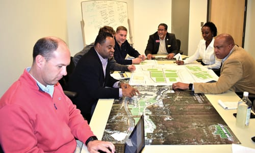 Bill Rowse (wearing red jacket), Vaughn Irons, Ray Bernabei, and Chris Daniluk discuss their site plans with Mayor Jason Lary, Economic Development Manager Sabrina Wright and Assistant City Manager Plez Joyner. Photo provided