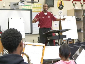 Salem Middle School's Band Director H. T. Monte conducts members of the band during a rehearsal . Photo by Travis Hudgons/OGC News