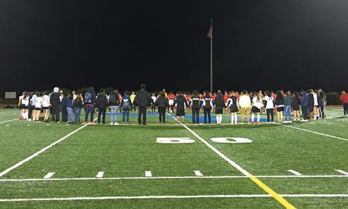 Cross Keys High School's soccer team has a moment of silence Feb. 13 for Miguel Jaimes Martinez, who became ill and died from flu complications. Photo by Travis Hudgons/OCGNews