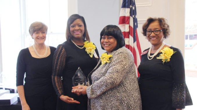 L-R: Wearing smiles, pearls and yellow corsages in honor of the Servant Leader Award are State Rep. Sherri Gilligan, co-chair of the Georgia Legislative Women's Caucus, former Rep. Nikki T. Randall, Joyce Reid and State Rep. Karen Bennett.