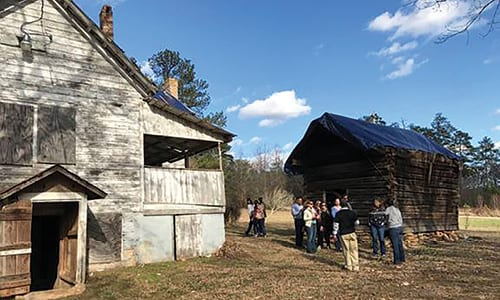Members from the Alliance of National Heritage Areas tour the historic Lyon Farm in early January 2017. Photos provided