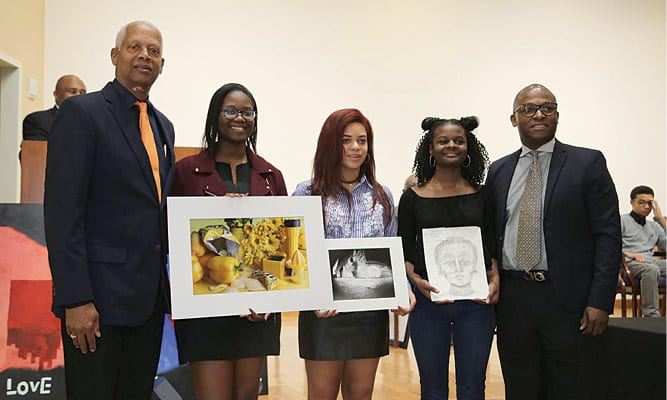 Congressman Hank Johnson recognizes the first, second and third runners-up of his art competition, from left: Sindi Patani of Brookwood; Elizabeth Claire Patton of St. Pius X Catholic High School; Esther Gibbs of Arabia Mountain High School; and Maurice Gay of The Art Institute of Atlanta. Photos provided