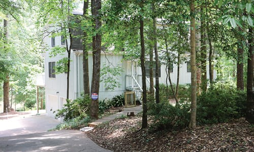 Ruth Johnson Floyd said the vacation rental on Panola Lakes Circle, pictured above, has created problems for neighbors. Photos by Glenn L. Morgan