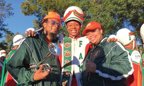 Cori Renee Bostic, center, poses with her parents at FAMU Homecoming game. Photo via Facebook