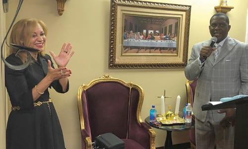 Pastor Debbie E. Hawkins applaudes Bishop Gary Hawkins during the Face of Victory Church's anniversary celebration. Photos by Glenn L. Morgan