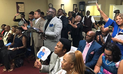 The congregation and visitors rejoicing during Bishop Hawkins' message.
