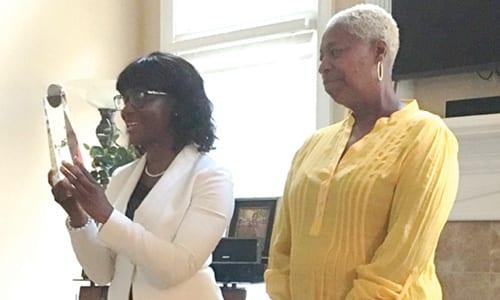 Stonecrest District 5 Councilwoman Diane Adoma  presented the Cynthia Houston Award to Idonia Hunter on Aug. 25.