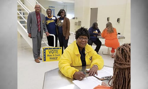 Standing: Sheriff Mann, DeKalb NAACP Political Action Chair Vivian Moore, and DeKalb NAACP President Teresa Hardy. Seated back: DeKalb NAACP Executive Member Louise Thompson with a new voter. Seated, foreground: Georgia State NAACP President Phyllis Blake and a new vote.