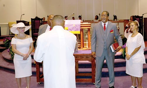 L-R: Angel Veasley and Deacon Reginald Veasley and Deacon Mayor Jason Lary and Debbie Lary are presented to the congregation. Photo by Glenn L. Morgan