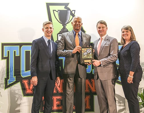 GDEcD Deputy Commissioner of Tourism Kevin Langston joins GDEcD Commissioner Pat Wilson and GACVB President Rashelle Beasley to present The Bill Hardman Sr. Tourism Government Champion Award to Congressman Hank Johnson.
