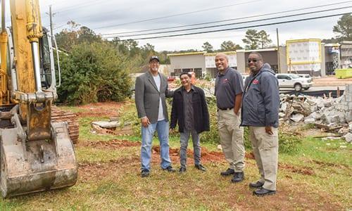 L-R: Stonecrest Mayor Jason Lary, property owner Salim Damani, Code Enforcement Manager Alejandro Ferrell and Officer William Kirkland. Photo provided