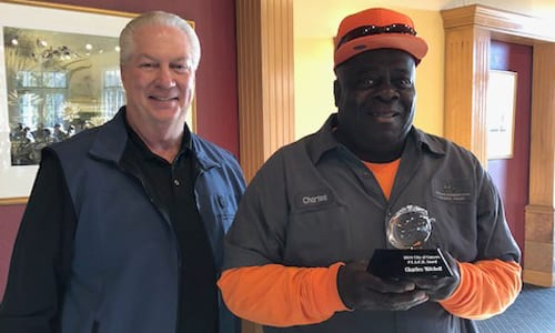 City Manager Tony Lucas with P.E.A.C.H. Award recipient GIHP's Charles Mitchell.