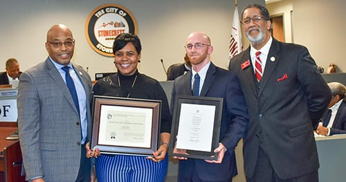 Pictured: City Manager Michael Harris, City Accounts Manager Audrey Mays, James Pence of Mauldin and Jenkins, the city's external auditing firm, and Mayor Jason Lary. Photo provided